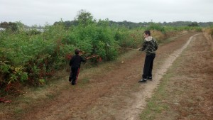 boys will be boys- sword fighting with reeds!